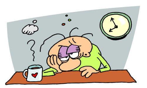 homem com cara de sono porque não dormiu bem